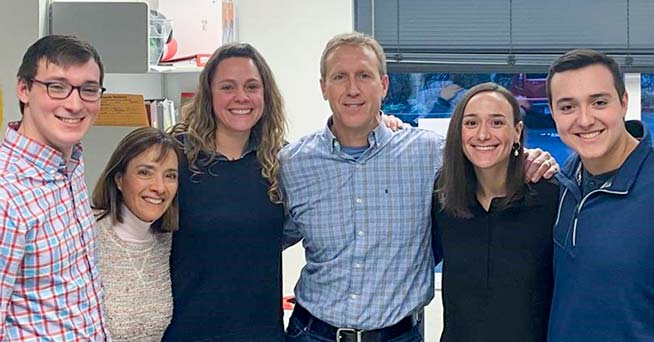 The Fleischauer family visits the Adair lab: Matt (left), Kristin, Dr. Adair, Mark, Kari and Mason.
